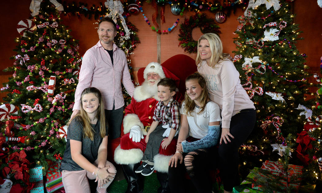The Willis family poses for a photograph with Santa Claus at the District at Green Valley Ranch in Henderson, Saturday, Nov. 24, 2018. Caroline Brehman/Las Vegas Review-Journal