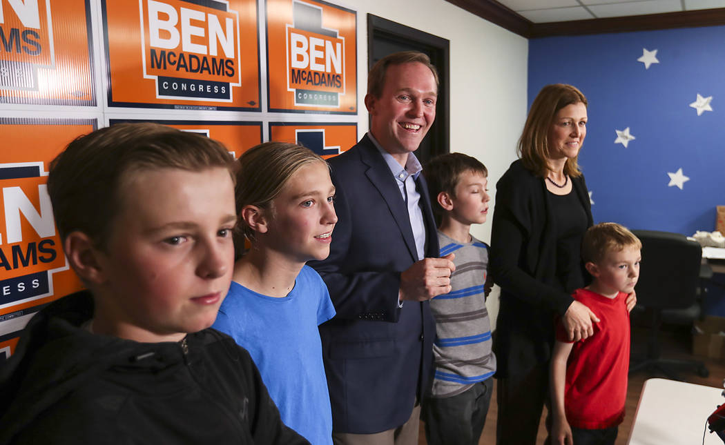 Democratic Salt Lake County Mayor Ben McAdams stands with his family as he speaks at a news conference, Monday, Nov. 19, 2018, in Millcreek, Utah. McAdams declared victory Monday night in the tigh ...