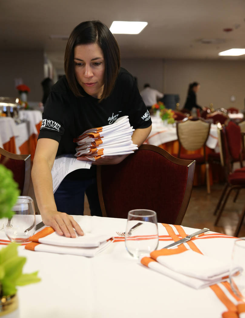 Wynn Las Vegas Executive Director Restaurant Operations Julia Greenman prepares for Thanksgiving dinner catered by casino at the Shade Tree shelter for homeless women and children in Las Vegas Wed ...