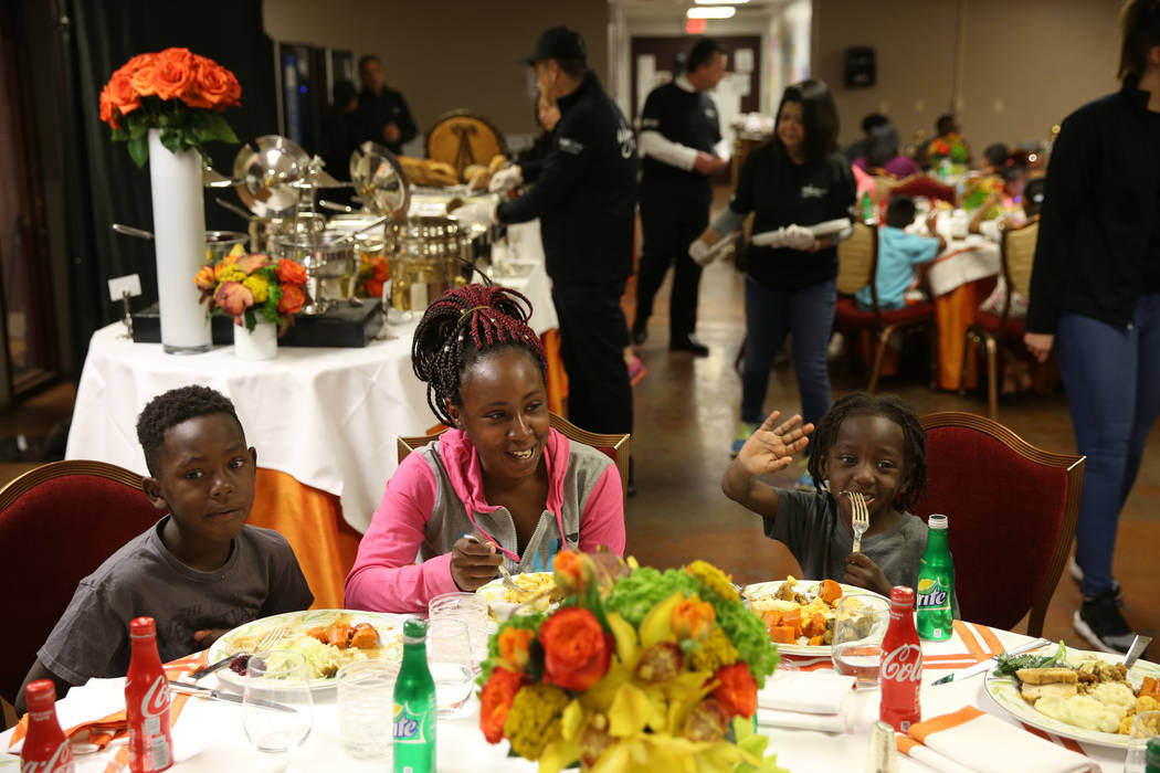 Todiah Coleman and her sons Jaurice Lee, 9, and Tarrice Lee, 5, enjoy Thanksgiving dinner catered by Wynn Las Vegas at the Shade Tree shelter for homeless women and children in Las Vegas Wednesda ...