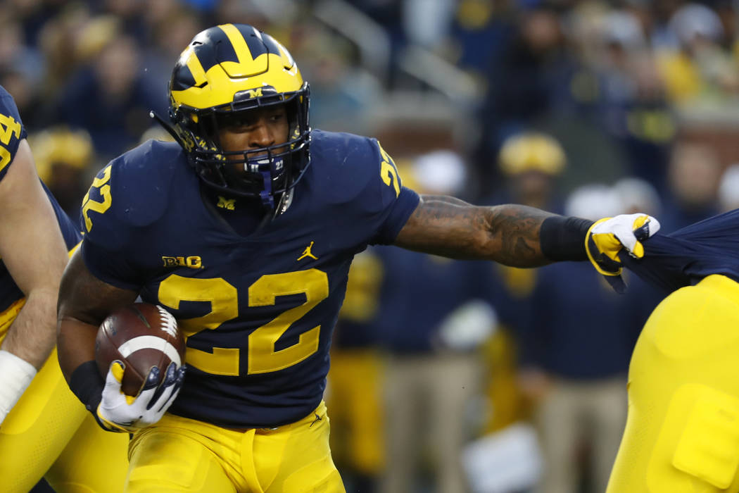 Michigan running back Karan Higdon (22) runs against Indiana in the first half of an NCAA college football game in Ann Arbor, Mich., Saturday, Nov. 17, 2018. (AP Photo/Paul Sancya)