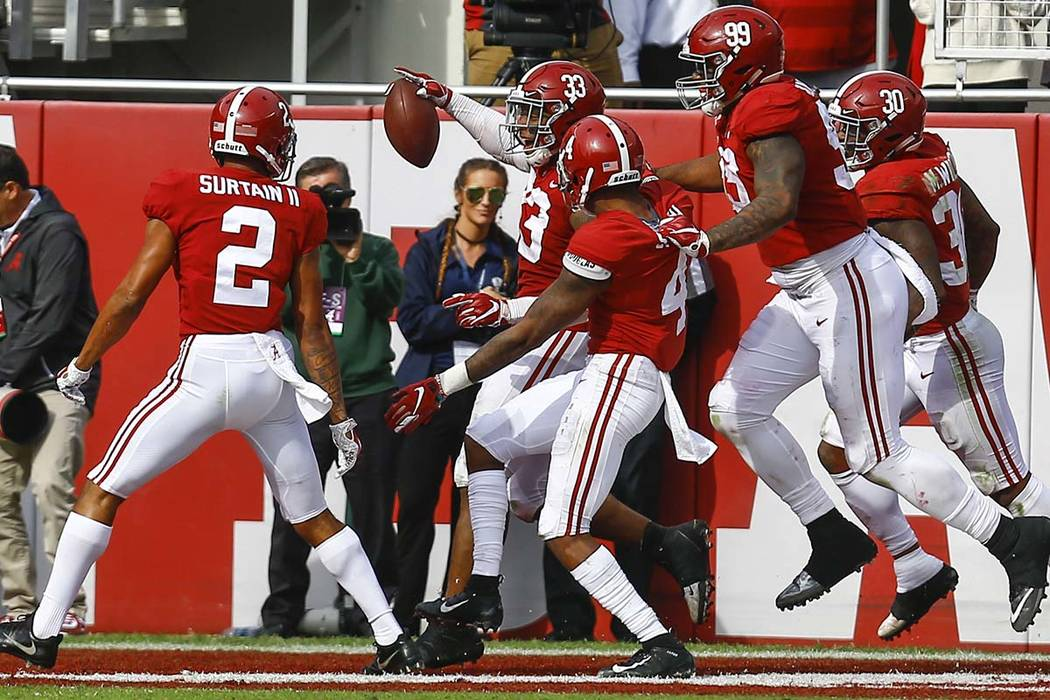 Alabama linebacker Anfernee Jennings (33) celebrates with teammates after recovering a fumble and returning it for a touchdown against Citadel during the second half of an NCAA college football ga ...