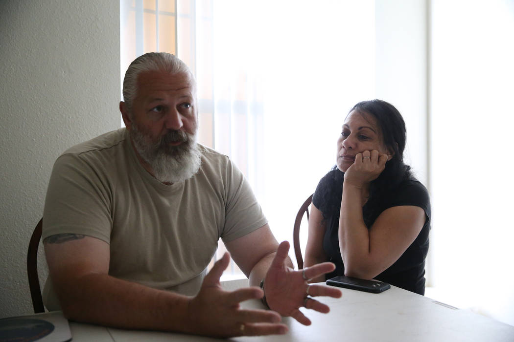 Heath Burkhalter, left, and his wife Verginia are interviewed at their Las Vegas apartment, Thursday, Aug. 30, 2018. The couple was displaced by one of the fires at the Solaire Apartments complex ...