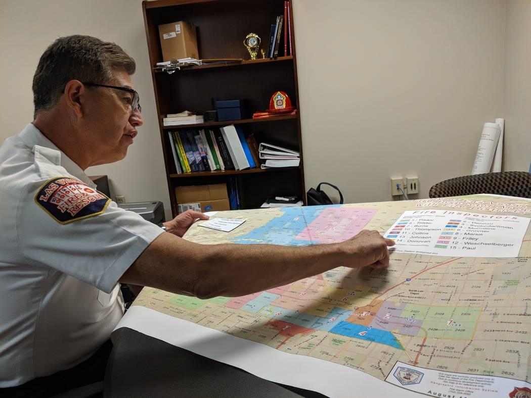 Las Vegas Fire Marshal/Assistant Chief Robert Nolan looks over a map that shows the city of Las Vegas fire inspector coverage area, in his office on Thursday, Aug. 16, 2018. Jamie Munks, Las Vegas ...