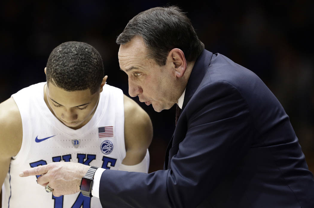 Duke head coach Mike Krzyzewski speaks with Jordan Goldwire during the second half of an NCAA college basketball game against Eastern Michigan in Durham, N.C., Wednesday, Nov. 14, 2018. Duke won 8 ...