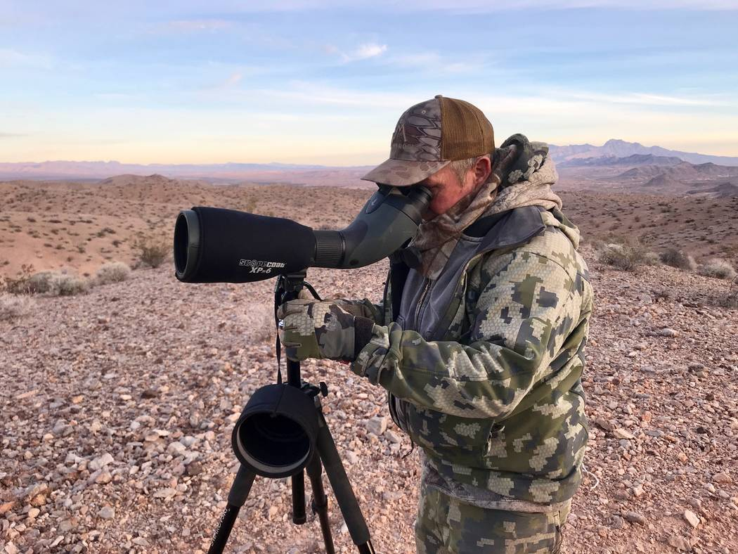 Good glass is the key to finding bighorn sheep in the rough terrain they call home. (Doug Nielsen)