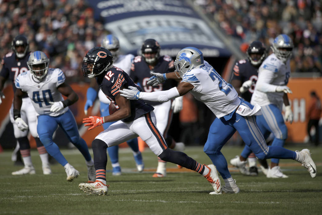 Chicago Bears wide receiver Allen Robinson (12) runs against Detroit Lions defensive back DeShawn Shead (26) during the first half of an NFL football game Sunday, Nov. 11, 2018, in Chicago. (AP Ph ...