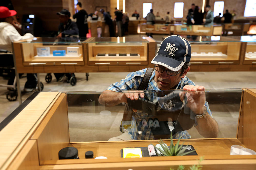A customer who declined to give his name checks out product at Planet 13, which bills itself as one of the largest dispensaries in the world, Thursday, Nov. 1, 2018. The marijuana store opened its ...