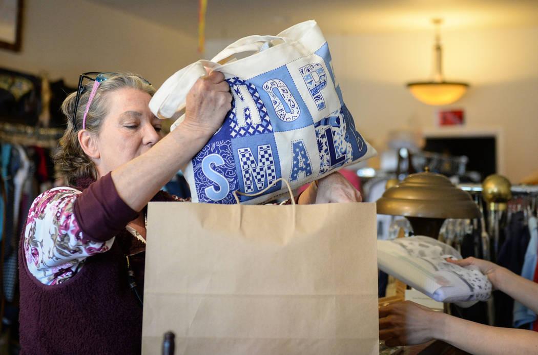 Henderson resident Corinne Vaughn makes a purchase at the children's clothing store Archer + Jane during Shop Small Henderson in Henderson, Saturday, Nov. 24, 2018. Caroline Brehman/Las Vegas Revi ...