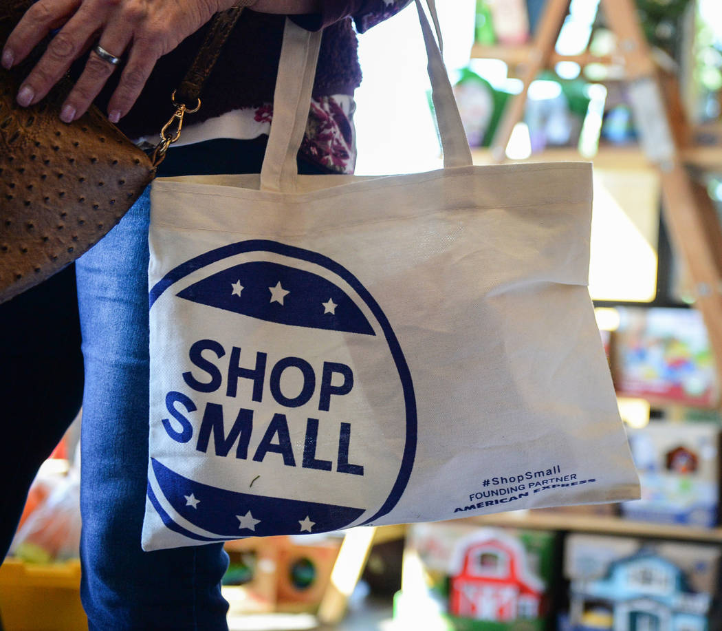 Henderson resident Corinne Vaughn carries a shop small tote bag during Shop Small Henderson in Henderson, Saturday, Nov. 24, 2018. Caroline Brehman/Las Vegas Review-Journal