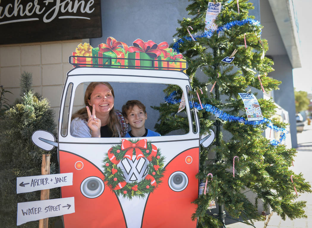 Henderson residents Diane Shearin, left, and Elijah Shearin, 8, pose for a photograph at a display set up on Water Street during Shop Small Henderson in Henderson, Saturday, Nov. 24, 2018. Carolin ...