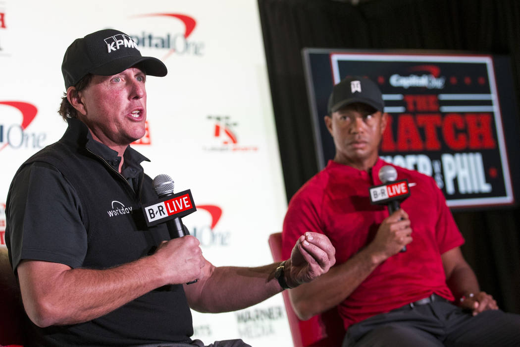 Phil Mickelson, left, and Tiger Woods take questions during a press conference at Shadow Creek Golf Course in North Las Vegas on Tuesday, Nov. 20, 2018. The golfers will compete in a match play ev ...