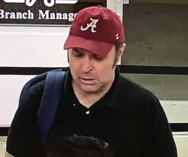 Police are asking for the public's help in identifying a man shown on surveillance cameras in connection with a Tuesday robbery at America First Credit Union, located at 6090 S. Durango Dri ...