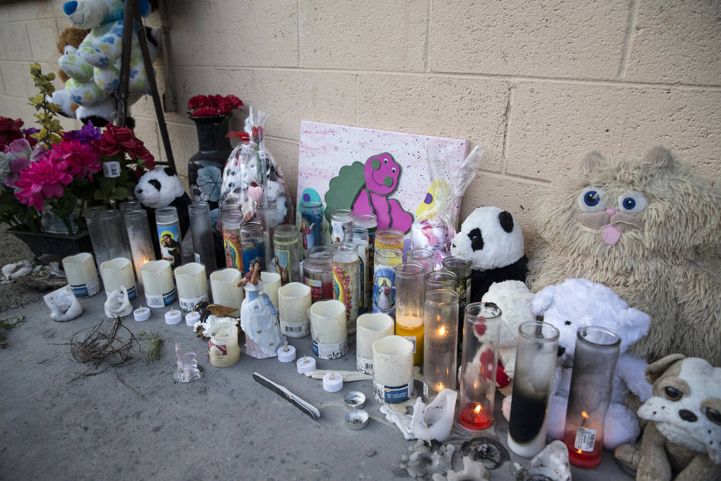 This February 2017 file shows a makeshift memorial at Westlake Apartments where Diana Bankstown and her 8-year-old daughter, Kaysha Ray, died on Jan. 19, 2017. (Erik Verduzco/Las Vegas Review-Jour ...