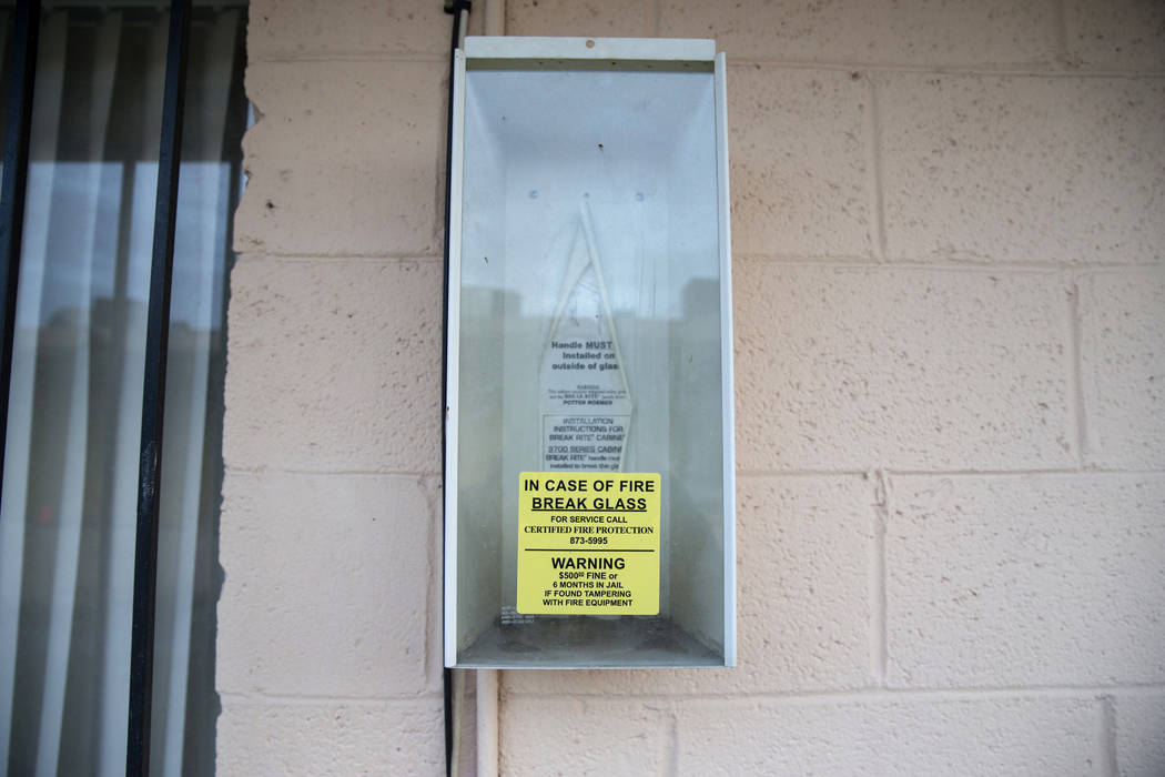 This February 2017 file photo shows an empty fire extinguisher box at Westlake Apartments where Diana Bankstown and her 8-year-old daughter, Kaysha Ray, died on Jan. 19, 2017. (Erik Verduzco/Las V ...