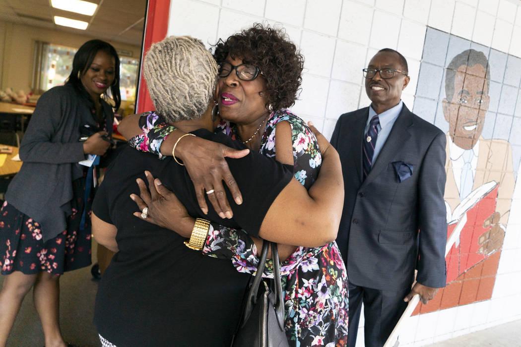 Doris Smith, grandmother of Kaysha Ray, center right, hugs kindergarten teacher Carla Kelly at Matt Kelly Elementary School in Las Vegas, Monday, Sept. 10, 2018. Kaysha Ray was eight-years-old whe ...
