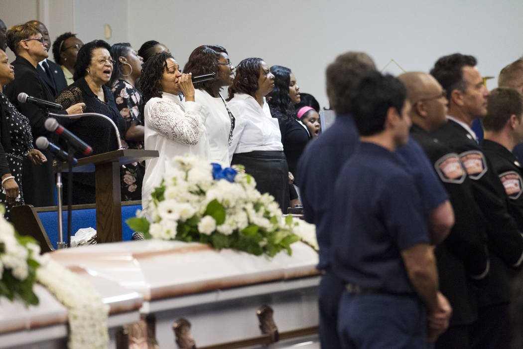 Laura Manson, center, sings in the choir during the funeral service for Diana Bankston and her 8-year-old daughter Kaysha Ray, at True Love Missionary Baptist Church, Saturday, Feb. 4, 2017, in La ...