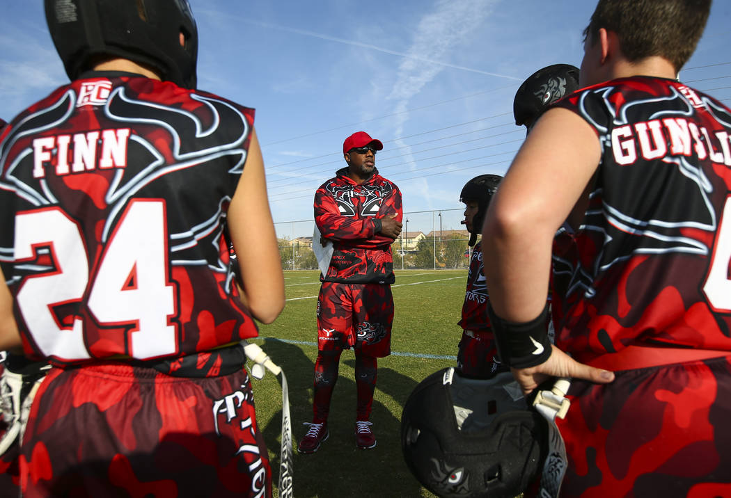 Apex Predators head coach Omar Smith talks with his team at halftime during a National Youth Sports Nevada flag football game at Aventura Park in Henderson on Saturday, Nov. 17, 2018. Chase Steven ...