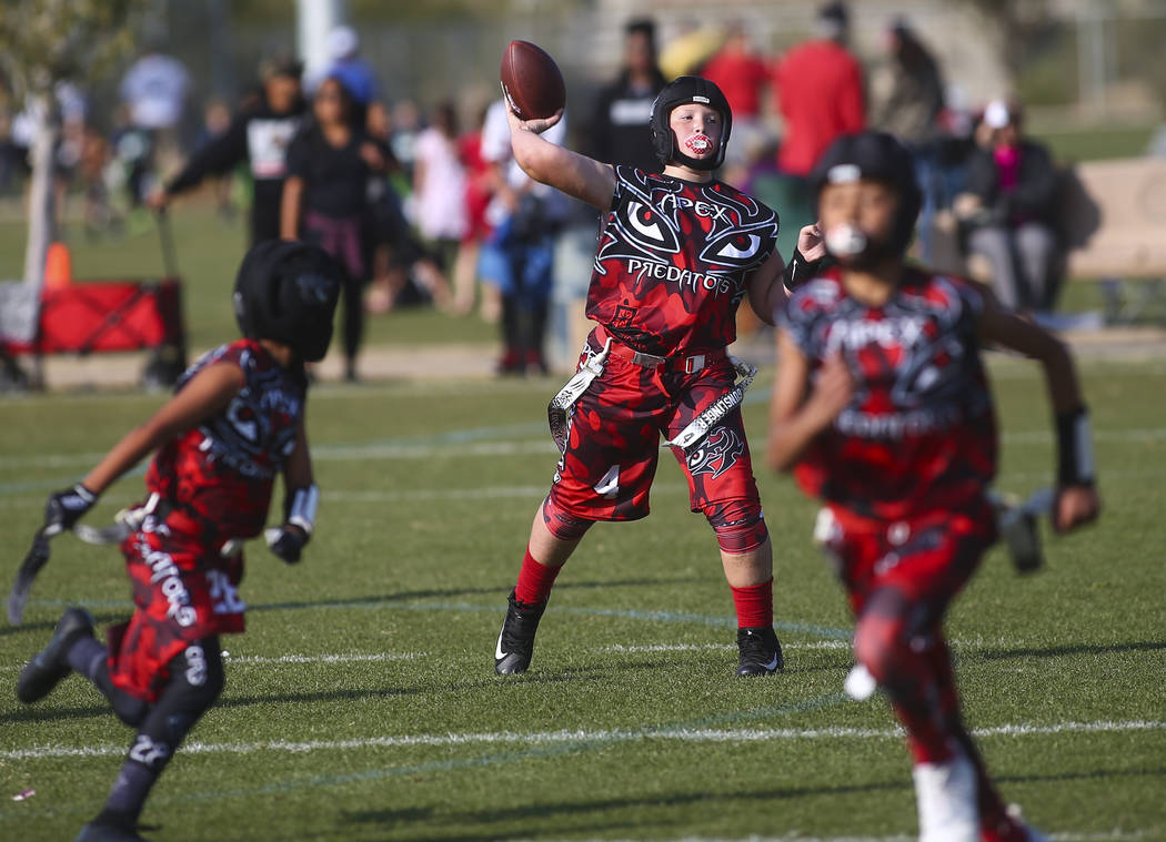 Apex Predators' Vincent Hales (4) looks to throw a pass while playing against the Ballers during a National Youth Sports Nevada flag football game at Aventura Park in Henderson on Saturday, Nov. 1 ...