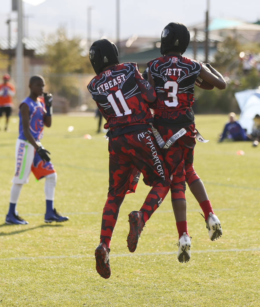 Apex Predators' Jett Washington (3) celebrates his touchdown with Tyrese Smith (11) while playing against the Ballers during a National Youth Sports Nevada flag football game at Aventura Park in H ...