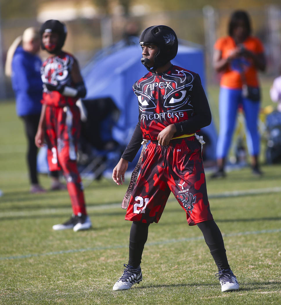 Apex Predators' Darius McClendon looks on while playing against the Ballers during a National Youth Sports of Nevada championship flag football game at Aventura Park in Henderson on Saturday, Nov. ...