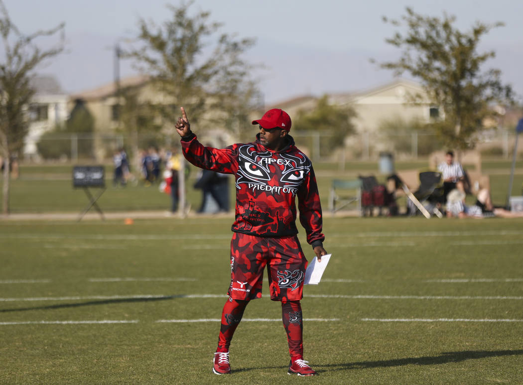 Apex Predators head coach Omar Smith motions to his team while playing against the Ballers during a National Youth Sports Nevada flag football game at Aventura Park in Henderson on Saturday, Nov. ...