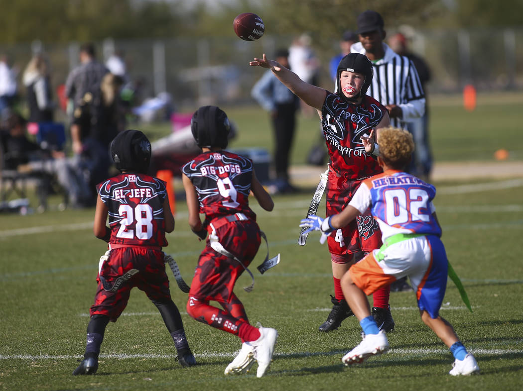 Apex Predators' Vincent Hales (4) throws a pass while playing against the Ballers during a National Youth Sports Nevada flag football game at Aventura Park in Henderson on Saturday, Nov. 17, 2018. ...