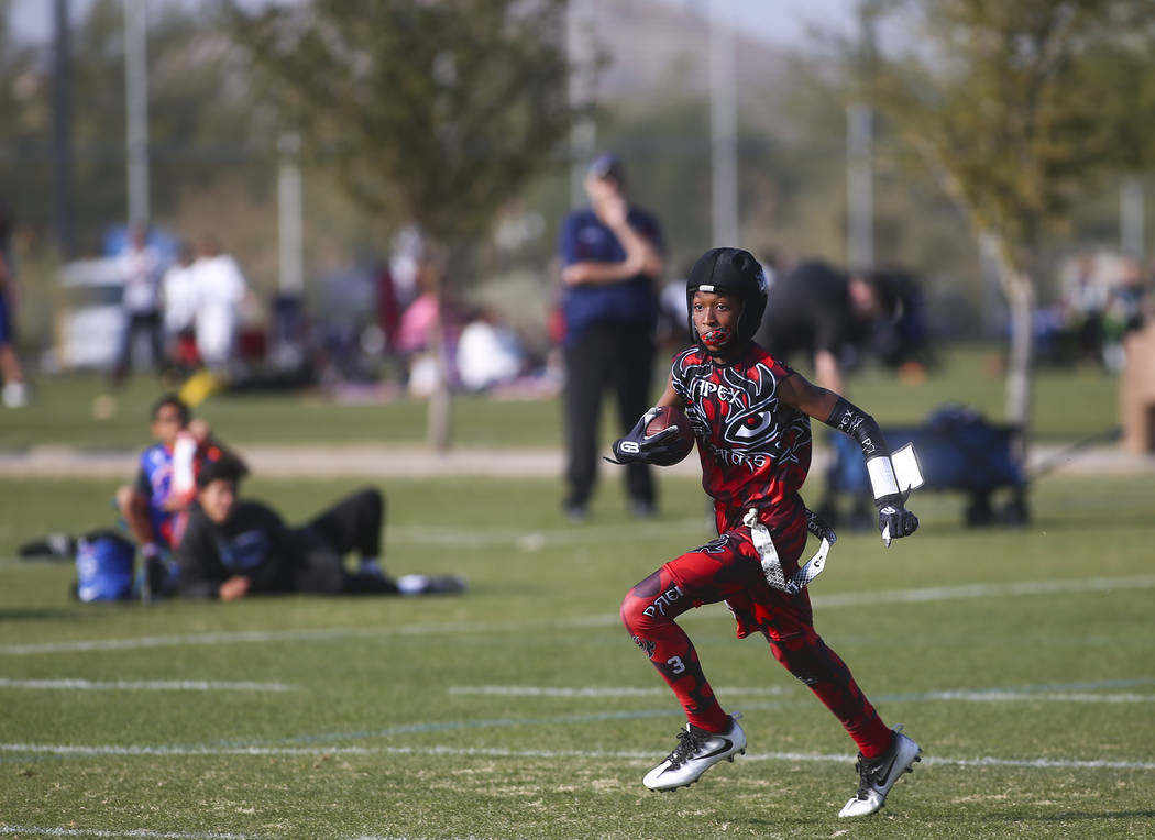 Apex Predators' Jett Washington runs the ball while playing against the Ballers during a National Youth Sports Nevada flag football game at Aventura Park in Henderson on Saturday, Nov. 17, 2018. C ...