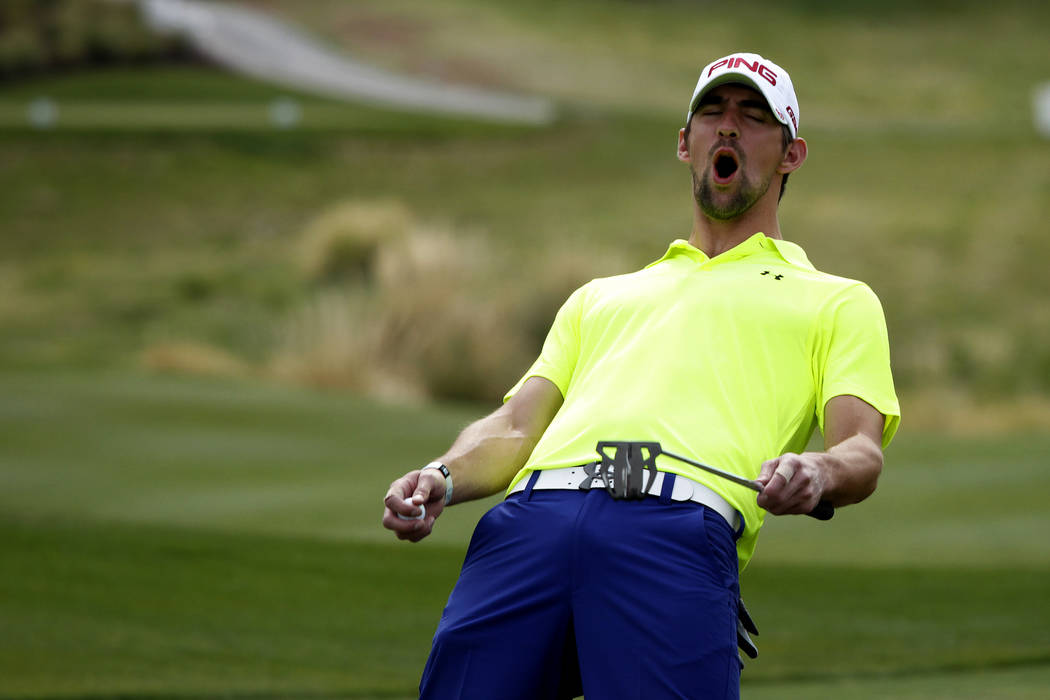 Michael Phelps reacts to a put by a teammate during the Michael Jordan Celebrity Invitational at the Shadow Creek Golf Course in North Las Vegas Thursday, April 4, 2013. (John Locher/Las Vegas Re ...