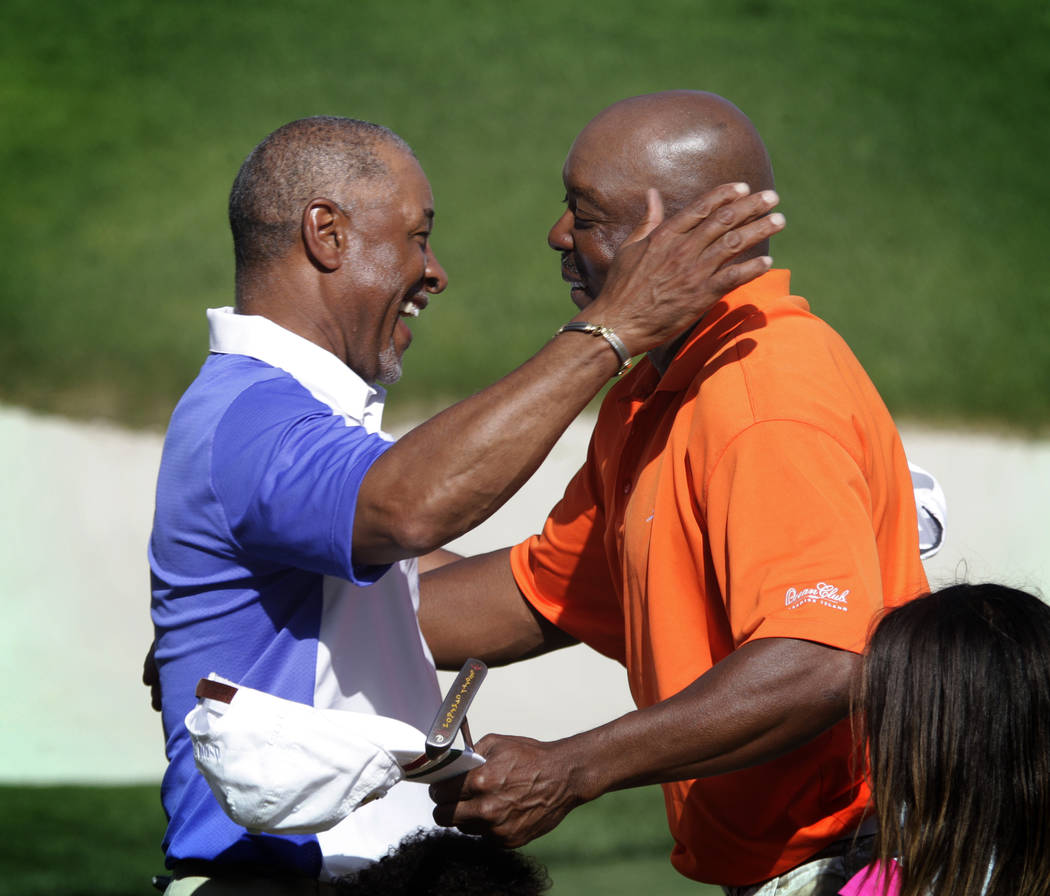 Ozzie Smith, left, and Vince Coleman go in for a hug after winning the Michael Jordan Celebrity Invitational at Shadow Creek Golf Course in North Las Vegas on Sunday, Apr. 7, 2013. (Jessica Ebelha ...