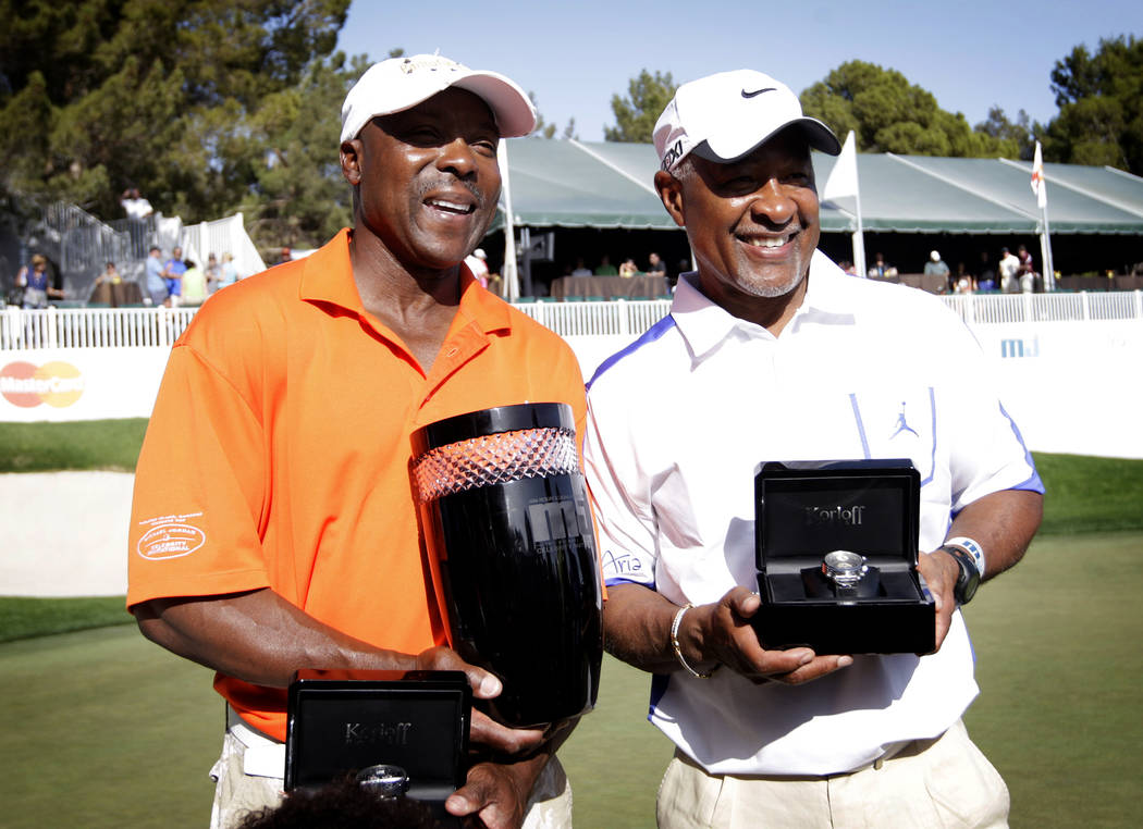 Vince Coleman, left, and Ozzie Smith pose for photos after winning the Michael Jordan Celebrity Invitational at Shadow Creek Golf Course in North Las Vegas on Sunday, Apr. 7, 2013. (Jessica Ebelha ...