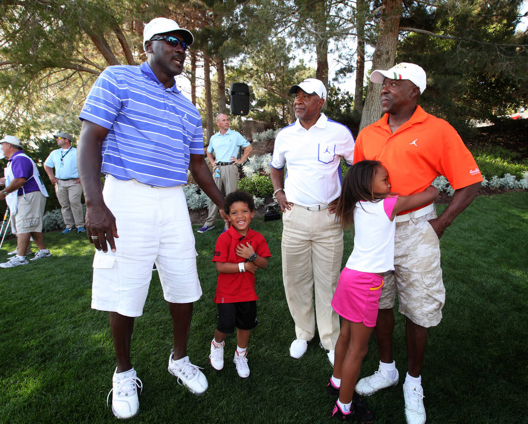 Michael Jordan, top left, Ozzie Smith, top center, and Vince Coleman, top right, chat after Smith and Coleman won the Michael Jordan Celebrity Invitational at Shadow Creek Golf Course in North Las ...