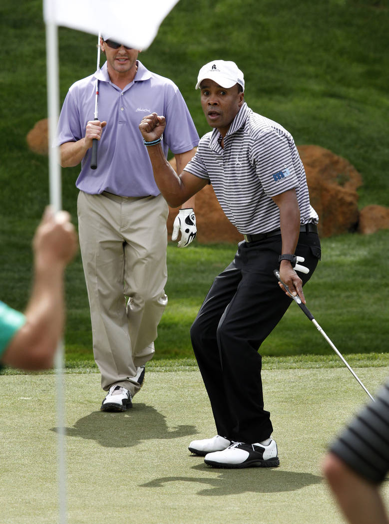 Sugar Ray Leonard reacts after nearly missing a put on the 9th green during the Michael Jordan Celebrity Invitational golf tournament at Shadow Creek golf course in North Las Vegas Thursday, March ...