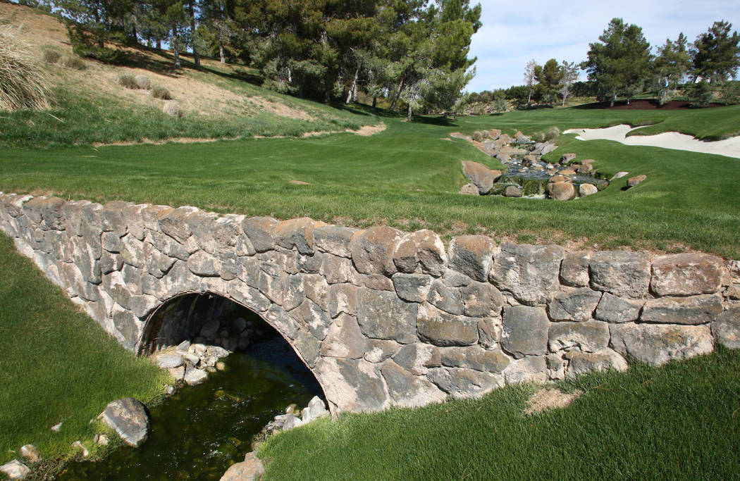 A view of the first fairway of the Shadow Creek Golf Club, which features a arch bridge made of stone over a creek and grass walk-way is shown on Tuesday, March 22, 2011. The course is located at ...