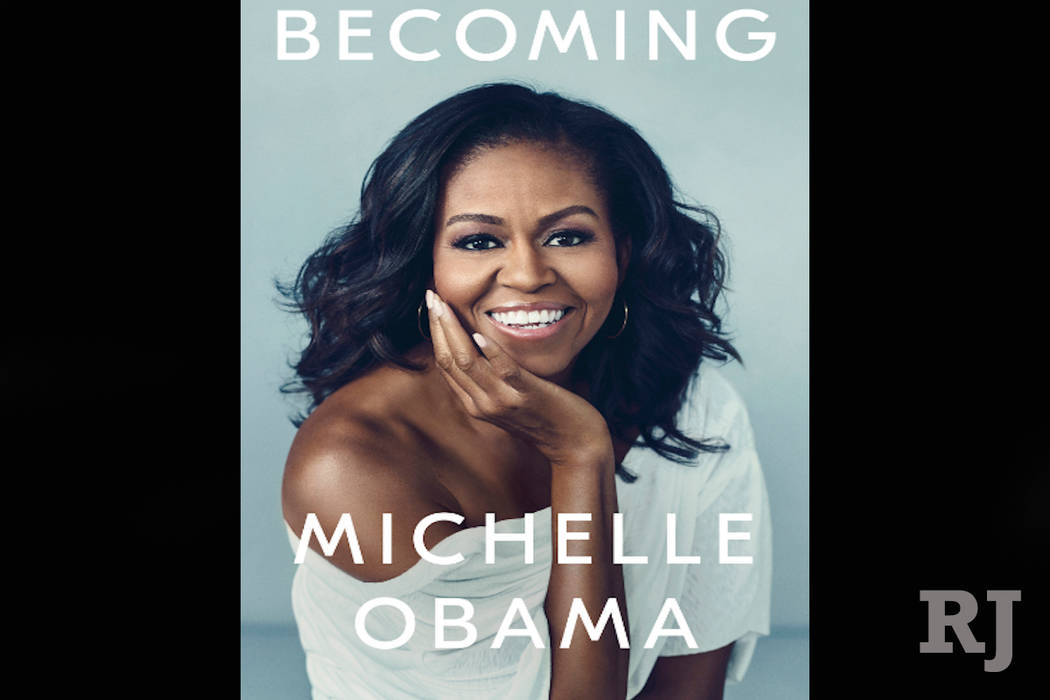 """This cover image released by Crown shows """"Becoming,"""" by Michelle Obama. Crown Publishing told The Associated Press on Friday that the former first lady's memoir had sold more than 725,000 copies ..."""