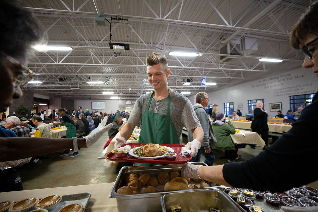 Musician Nick Carter, a member of the Backstreet Boys, loads up his tray with a Thanksgiving meal while volunteering at Catholic Charities of Southern Nevada in Las Vegas on Thursday, Nov. 22, 201 ...