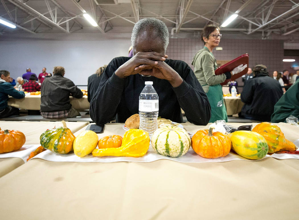 Luther Wyatt, formerly of California, bows in prayer before having his Thanksgiving meal at Catholic Charities of Southern Nevada in Las Vegas on Thursday, Nov. 22, 2018. Richard Brian Las Vegas R ...