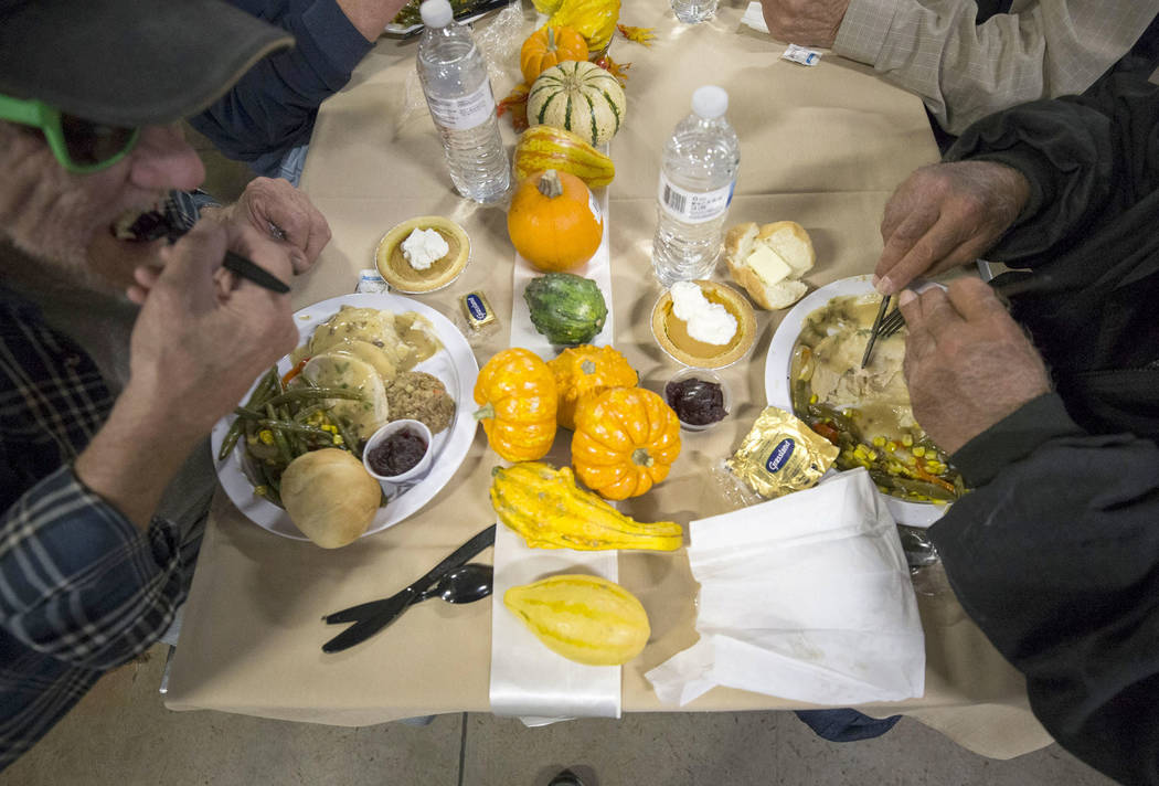 Guests enjoy their Thanksgiving meal at the St. Vincent Lied Dining Facility at Catholic Charities of Southern Nevada in Las Vegas on Thursday, Nov. 22, 2018. Richard Brian Las Vegas Review-Journa ...