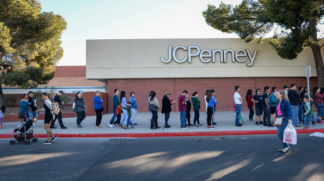 Customers wait in a line wrapped around the J.C. Penney building at the Meadows Mall as they wait to get early Black Friday deals on Thanksgiving in Las Vegas, Thursday, Nov. 22, 2018. Caroline Br ...