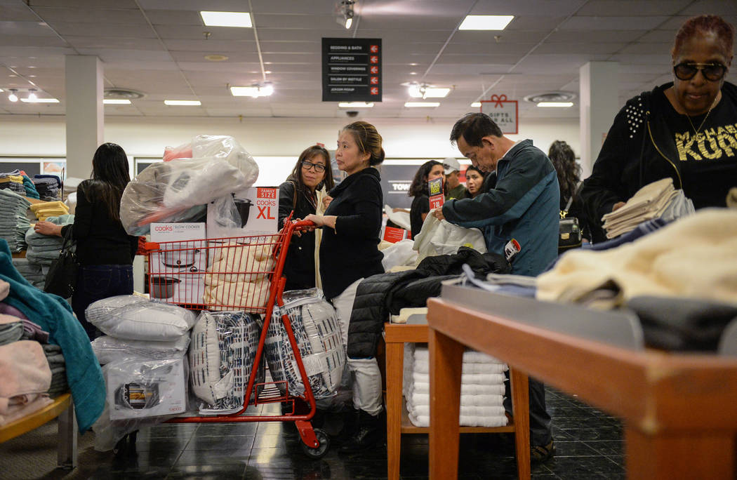 Customers wait in a line to purchase items with Black Friday deals at the J.C. Penney building at the Meadows Mall on Thanksgiving in Las Vegas, Thursday, Nov. 22, 2018. Caroline Brehman/Las Vegas ...