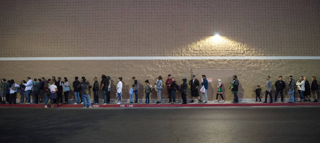 Customers wait in line at a Target off of North Tenaya Way as they wait to get early Black Friday deals on Thanksgiving in Las Vegas, Thursday, Nov. 22, 2018. Caroline Brehman/Las Vegas Review-Journal