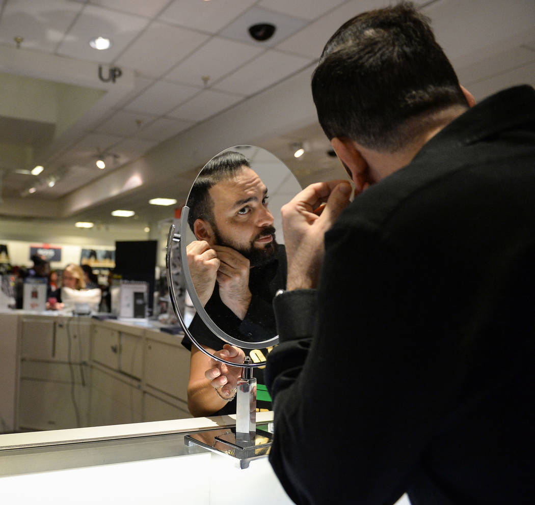 Iman Zaeri tries on earrings as he shops at the J.C. Penney at the Meadows Mall on Thanksgiving in Las Vegas, Thursday, Nov. 22, 2018. Caroline Brehman/Las Vegas Review-Journal