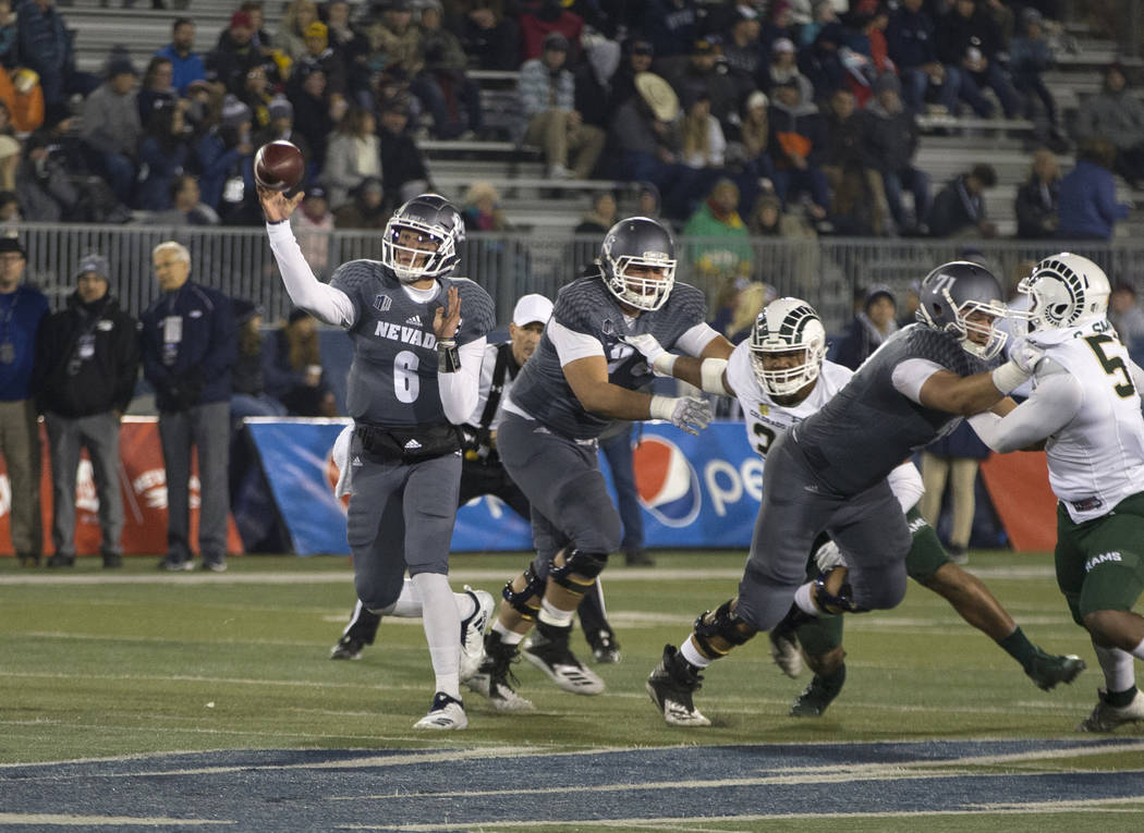 Nevada quarterback Ty Gangi (6) throws against Colorado State in the first half of an NCAA college football game in Reno, Nev., Saturday, Oct. 27, 2018. (AP Photo/Tom R. Smedes)