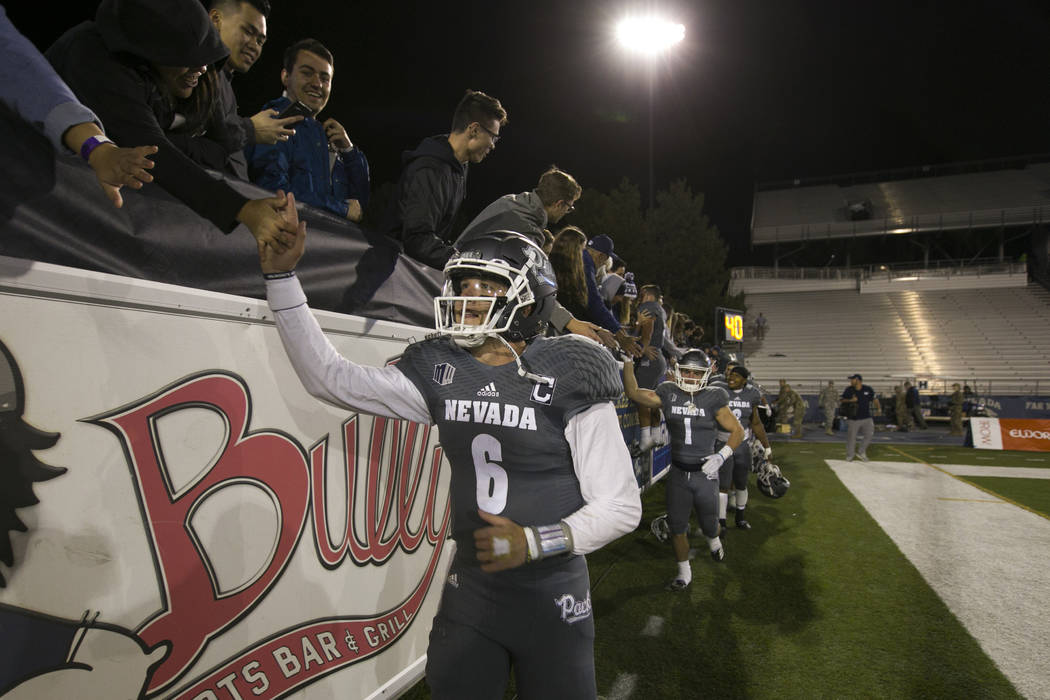 Nevada quarterback Ty Gangi (6) celebrates with his team and fans after beating San Diego State 28-24 in a NCAA college football game in Reno, Nev., Saturday, Oct. 27, 2018. (AP Photo/Tom R. Smedes)