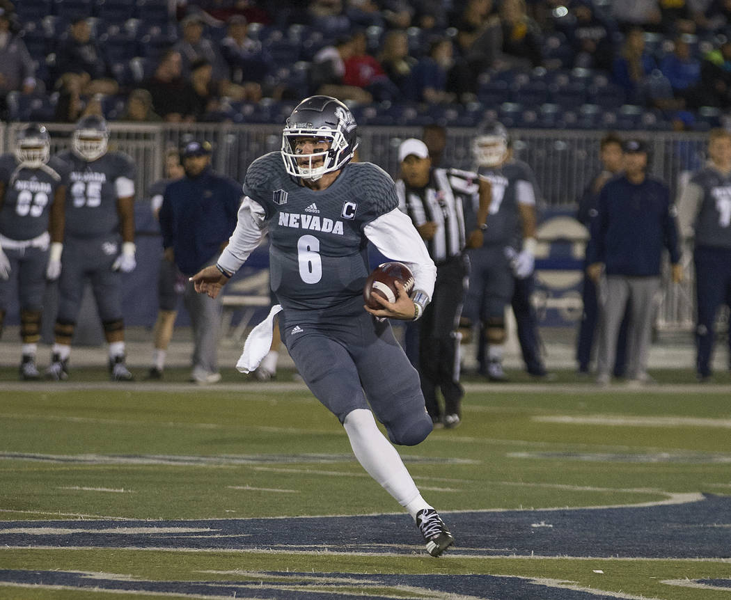 Nevada quarterback Ty Gangi (6) runs against San Diego State in the second half of an NCAA college football game in Reno, Nev., Saturday, Oct. 27, 2018. (AP Photo/Tom R. Smedes)