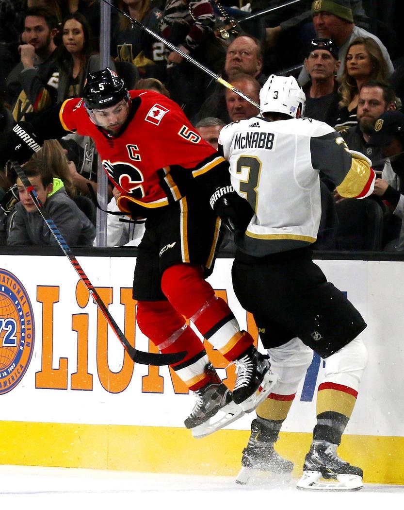 Calgary Flames defenseman Mark Giordano (5) collides with Vegas Golden Knights defenseman Brayden McNabb (3) during the second period of an NHL game in Las Vegas, Friday, Nov. 23, 2018. Heidi Fang ...