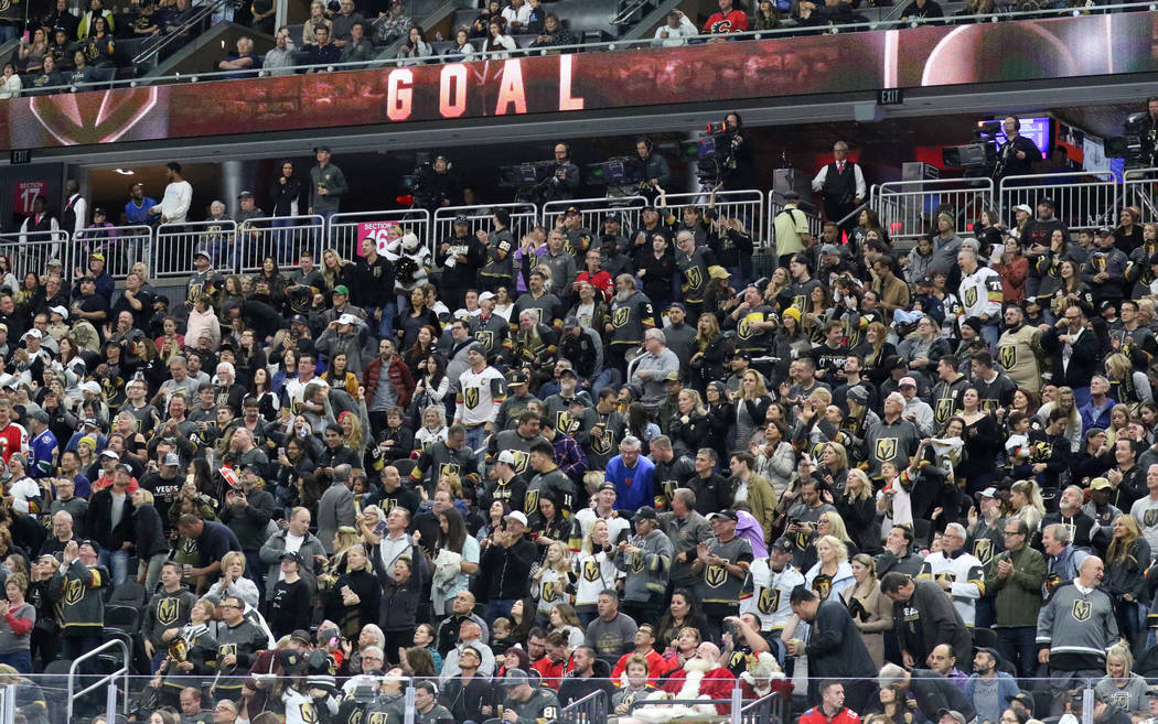 Vegas Golden Knights fans stand after defenseman Colin Miller's (6) goal during the third period of an NHL game against the Calgary Flames in Las Vegas, Friday, Nov. 23, 2018.