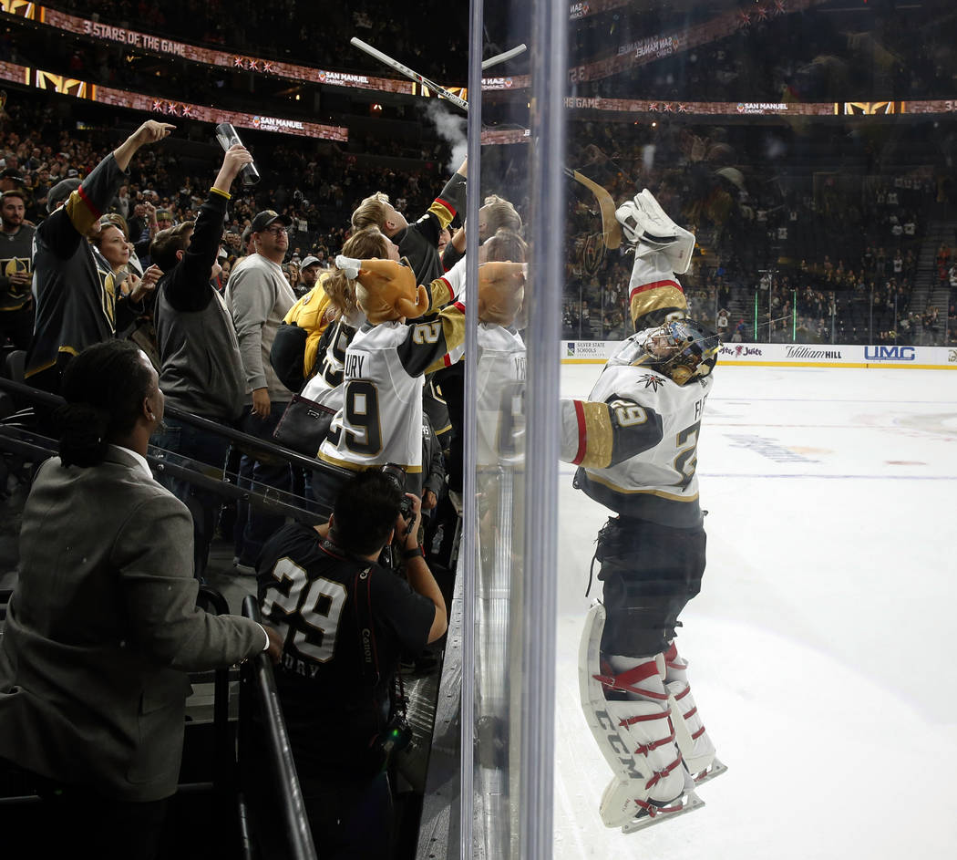 Vegas Golden Knights goaltender Marc-Andre Fleury (29) passes his stick to fans after shutting out the Calgary Flames during an NHL hockey game Friday, Nov. 23, 2018 in Las Vegas. (AP Photo/Joe Bu ...
