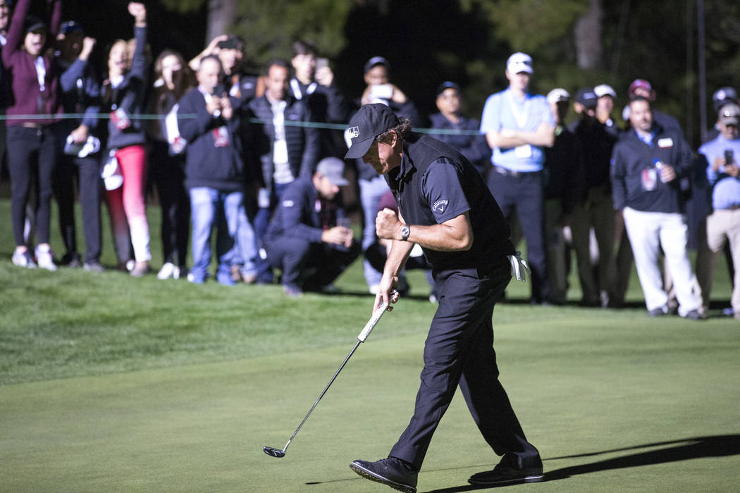 Phil Mickelson reacts after sinking a game winning putt to defeat Tiger Woods in The Match at Shadow Creek Golf Course in North Las Vegas on Friday, Nov. 23, 2018. Richard Brian Las Vegas Review-J ...