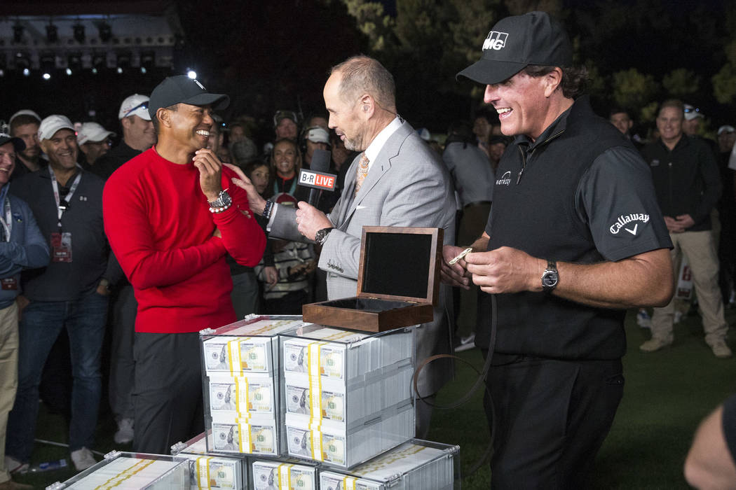 Tiger Woods, left, and Phil Mickelson do a post game interview after Mickelson won The Match at Shadow Creek Golf Course in North Las Vegas on Friday, Nov. 23, 2018. Richard Brian Las Vegas Review ...
